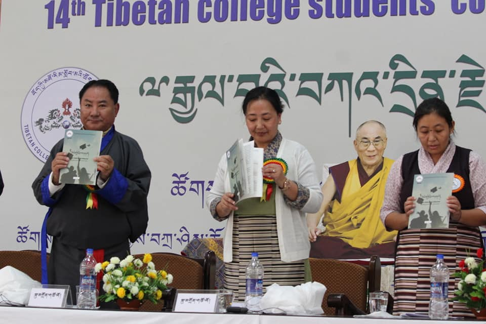 Speaker Pema Jungney addresses the closing ceremony of the 14th Tibetan College Students' Conference